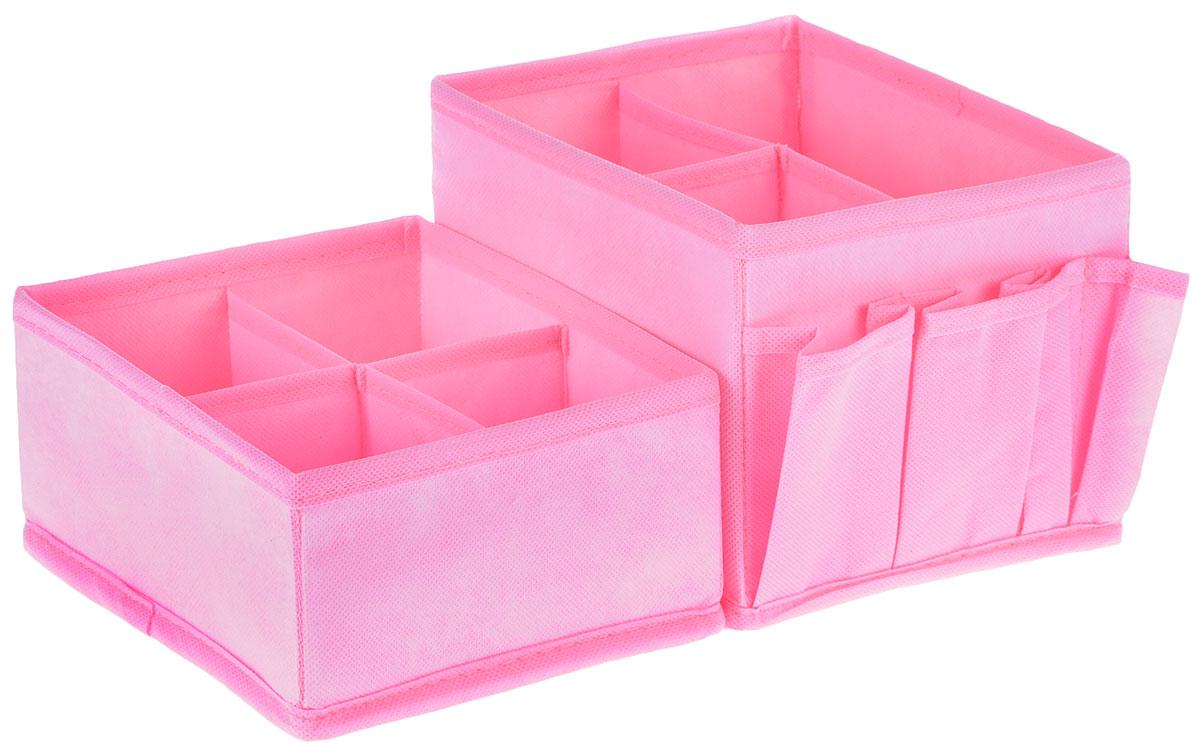 Набор органайзеров для косметики Все на местах Minimalistic, цвет: розовый, 2 предметаAHS861Набор состоит из двух органайзеров для хранения косметики и аксессуаров. Изделия выполнены из высококачественного нетканого материала (спанбонда), который обеспечивает естественную вентиляцию, позволяя воздуху проникать внутрь, но не пропускает пыль. Вставки из ПВХ хорошо держат форму. Мягкие перегородки образуют секции для хранения разнообразной косметики. Наружные кармашки позволяют удобно хранить мелкие аксессуары. Изделия отличаются мобильностью: легко раскладываются и складываются. Набор органайзеров для косметики и аксессуаров поможет привести элементы женского туалета в порядок. Оригинальный дизайн придется по вкусу ценительницам эстетичного хранения. Размер органайзеров: 15 см х 15 см х 14 см; 15 см х 15 см х 7 см.