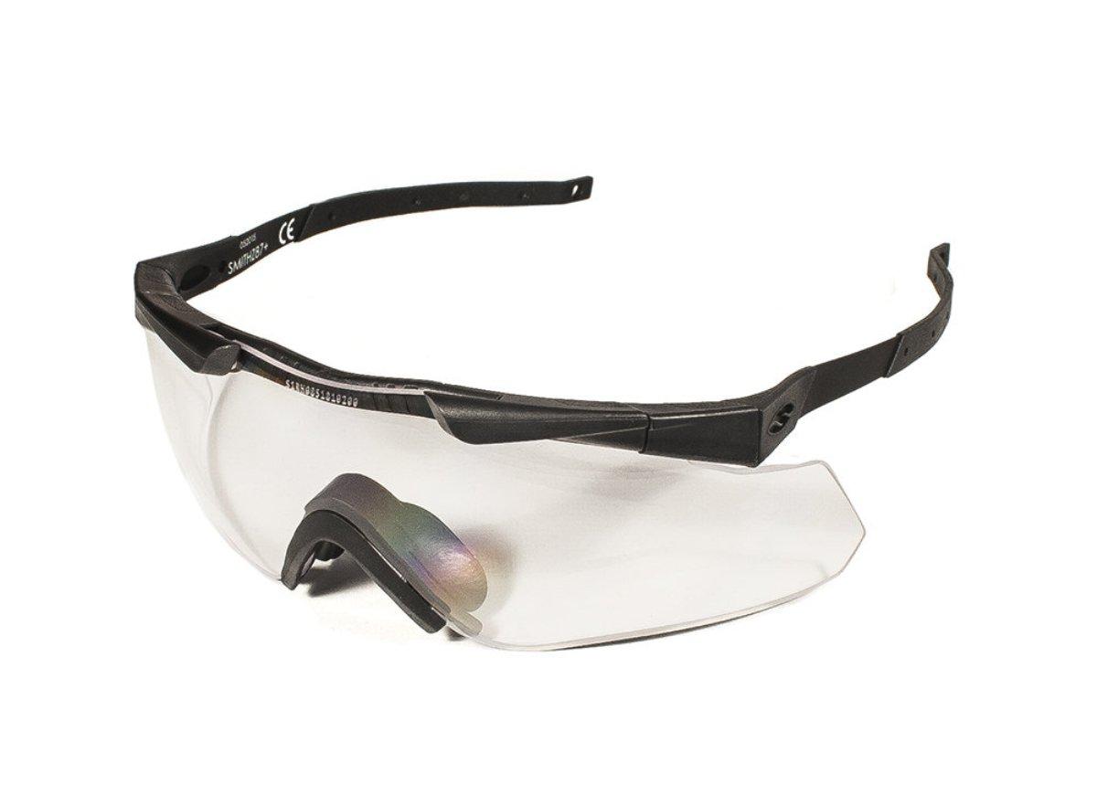 Защитные баллистические очки Smith Optics Aegis Echo II Compact, цвет: черныйINT-06501Защитные баллистические очки Smith Optics Aegis Echo II Compact - надежная защита органов зрения при ведении стрельбы. Модель пригодится охотникам, участникам спортивных соревнований и любителям экстремальных видов спорта. Стильные очки, рассчитанные на размер головы до 58 сантиметров, походят и для повседневного ношения.Тонкие металлические дужки при необходимости отгибаются, не давят, позволяя использовать очки с наушниками или шлемом. Комфортную посадку обеспечивает пластиковый наносник, который регулируется по ширине. Имеется эластичный ремешок для жесткой фиксации на голове.Линзы изготовлены из поликарбоната. Прочный материал выдерживает прямое попадание дроби, а также характеризуется отличными оптическими качествами. Запатентованное покрытие защищают глаза от ультрафиолета, предотвращают запотевание. Новейшие технологии гарантируют точность изображения и снижение нагрузки на глаза.При ярком освещении рекомендуется использовать затемненные линзы. Перестановка дужек и наносника происходит быстро и не требует применения инструментов.