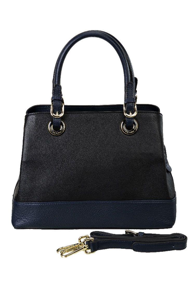 Сумка женская Vera Victoria Vito, цвет: черный. 33-701-1BA7426Симпатичная сумочка от Vera Victoria Vito выполнена из качественной натуральной кожи, будет уместна в любой ситуации. Ручки на ремешках и золотистых кольцах делает эту сумку по-настоящему стильным аксессуаром. Закрывается на молнию, по бокам два отдела на кнопках. С обратной стороны карман на молнии. Внутри сумка имеет одно отделение, кармашки для мелочей и небольшой карман на молнии для паспорта. Регулируемый ремень можно дополнительно подсоединять и использовать для носки через плечо.