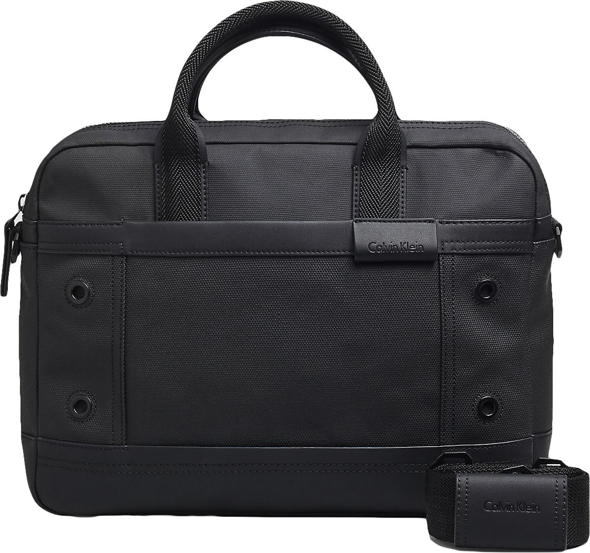 Сумка мужская Calvin Klein Jeans, цвет: черный. K50K502351_0010101225Стильная мужская сумка Calvin Klein Jeans выполнена из полиуретана и хлопка. Изделие имеет одно отделение, которое закрывается на застежку-молнию. Внутри сумки расположено отделение для ноутбука на липучке и два открытых кармана. Снаружи, на передней стенке находится нашивной карман на магнитной кнопке, на задней стенке - дополнительный открытый нашивной карман. Сумка оснащена двумя удобными ручками. В комплект входит съемный наплечный ремень, который регулируется по длине.Стильная сумка идеально подчеркнет ваш неповторимый стиль.