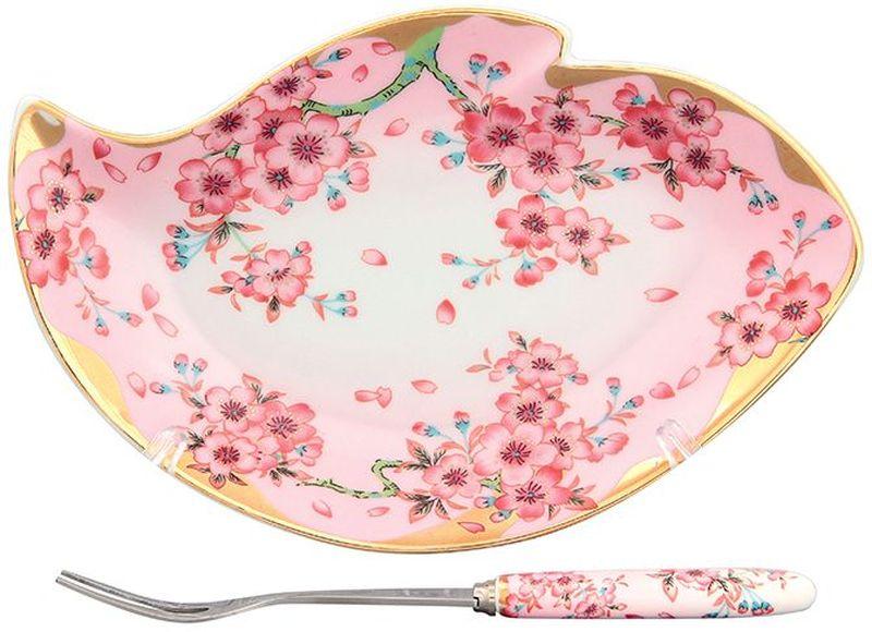 Тарелка под лимон Elan Gallery Сакура, с вилкой, 17 х 11 х 2 см115510Изящное блюдо Elan Gallery Сакура предназначено для нарезанных долек лимона с вилочкой для удобства. Изделие выполнено из керамики и оформлено оригинальным узором. Такая тарелка подойдет для сервировки любой нарезки. Изделие имеет подарочную упаковку, поэтому станет желанным подарком для ваших близких.Размер тарелки: 17 х 11 х 2 см.