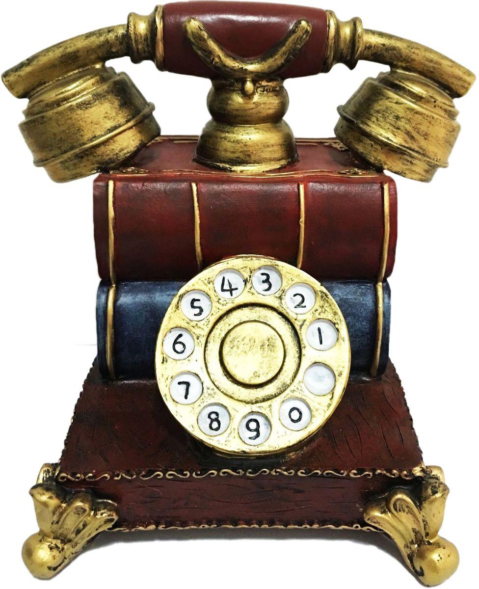 Копилка декоративная Magic Home Телефонный аппаратБрелок для ключейОригинальная копилка Телефонный аппарат, выполненная из высококачественной полирезины, станет отличным украшением интерьера дома или офиса. Копилка оснащена отверстием для монет и удобным клапаном на дне, через который можно достать деньги.Копилка послужит не только по своему прямому назначению, но и красиво дополнит интерьер комнаты, а оригинальный дизайн сделает ее прекрасным подарком для друзей и близких.
