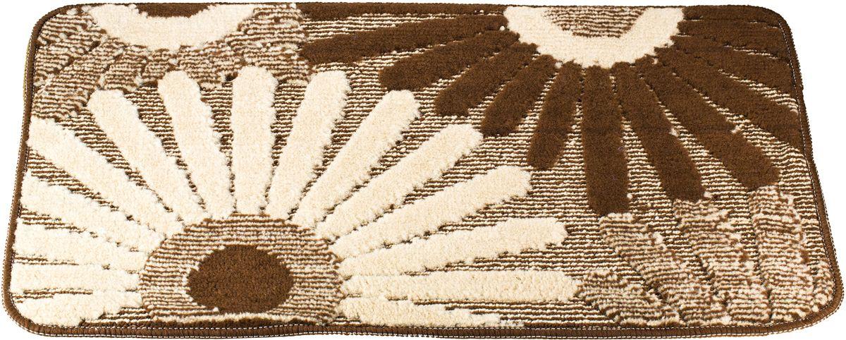 Коврик для ванной Swensa Fiori, цвет: коричневый, 50 х 80 смSWM-1016-BROWNПриятно после водных процедур встать босыми ногами не на холодный кафель, а на мягкую пушистую поверхность. А потому коврик Swensa Fiori - незаменимый атрибут в ванной комнате. Коврик с рисунком в виде соцветий выполнен в нейтральной природной цветовой гамме, изготовлен из полипропилена – материала, устойчивого к истиранию, долговечного и не боящегося влаги. Изделие быстро сохнет, допускается машинная стирка. Нескользящая подложка обезопасит владельцев от случайных падений.