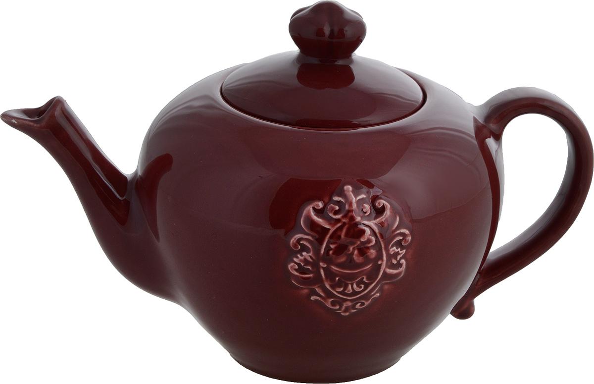 Чайник заварочный Nuova Cer Аральдо, цвет: бордовый, 1 лVT-1520(SR)Заварочный чайник Nuova Cer Аральдо изготовлен из высококачественной керамики. Глазурованное покрытие обеспечивает легкую очистку. Изделие прекрасно подходит для заваривания вкусного и ароматного чая, а также травяных настоев. Отверстия в основании носика препятствуют попаданию чаинок в чашку. Оригинальный дизайн сделает чайник настоящим украшением стола. Он удобен в использовании и понравится каждому.Не рекомендуется мыть в посудомоечной машине и использовать в микроволновой печи.Диаметр чайника (по верхнему краю): 8,5 см.Высота чайника (без учета крышки): 12 см.Высота чайника (с учетом крышки): 16 см.Ширина чайника (с учетом ручки и носика): 25 см.