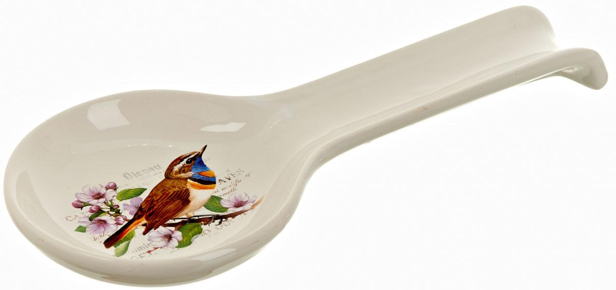 Подставка под ложку Polystar Birds, длина 28 смSC-FD421005Подставка под ложку Birds изготовлена из высококачественной керамики. Данное изделие оригинальной формы и декорирована изображением птицы. Подставка предназначена для поддержания чистоты на кухонном столе при приготовлении пищи. Поставьте ее рядом с плитой, и кладите на подставку ложку, половник или лопатку, которыми вы помешиваете блюда.