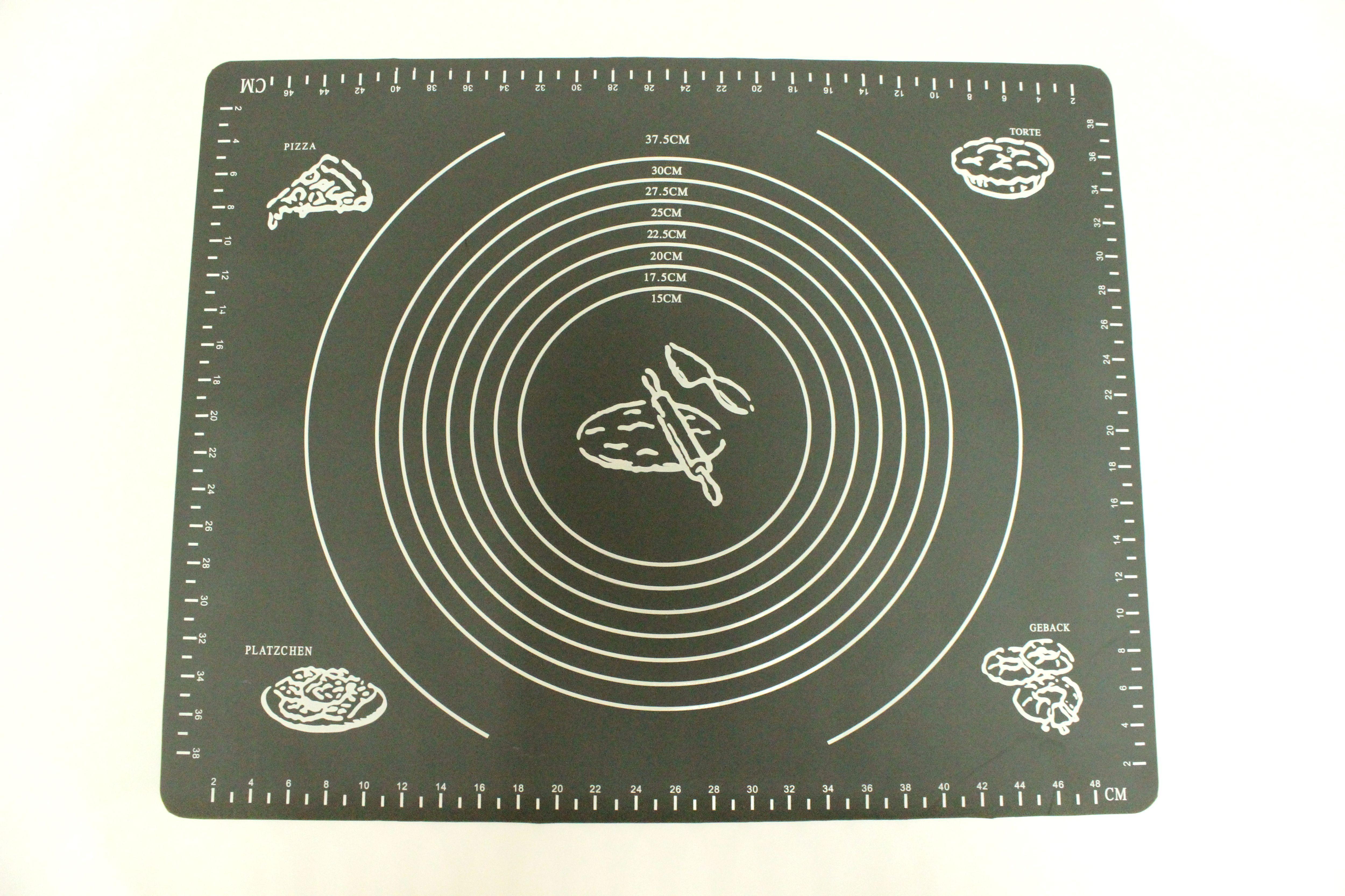 Коврик для выпечки Domodin, цвет: черный, 40 х 50 см94672Коврик для выпечки изготовлен из силикона, поэтому легко гнется и выдерживает температуру до +230 °С. Предназначен для гигиеничного приготовления любой выпечки из теста. Коврик оснащен мерной шкалой по краям (48 см х 38 см) и круглым шаблоном для теста (диаметр 15-37,5 см). Раскатывая тесто на таком коврике, вы всегда сможете придать ему нужный размер. Кроме того, тесто не прилипает. Коврик очень удобный и облегчит приготовление теста.