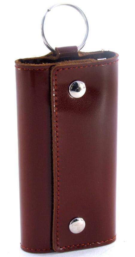 Ключница Befler Classic, цвет: коричневый. KL.3.-139864|Серьги с подвескамиКомпактная ключница Befler Classic - стильная вещь для хранения ключей. Ключница, закрывающаяся на две кнопки, выполнена из натуральной кожи высокого качества. Внутри ключницы расположены шесть металлических карабинов для ключей и дополнительное наружное кольцо для крепления.