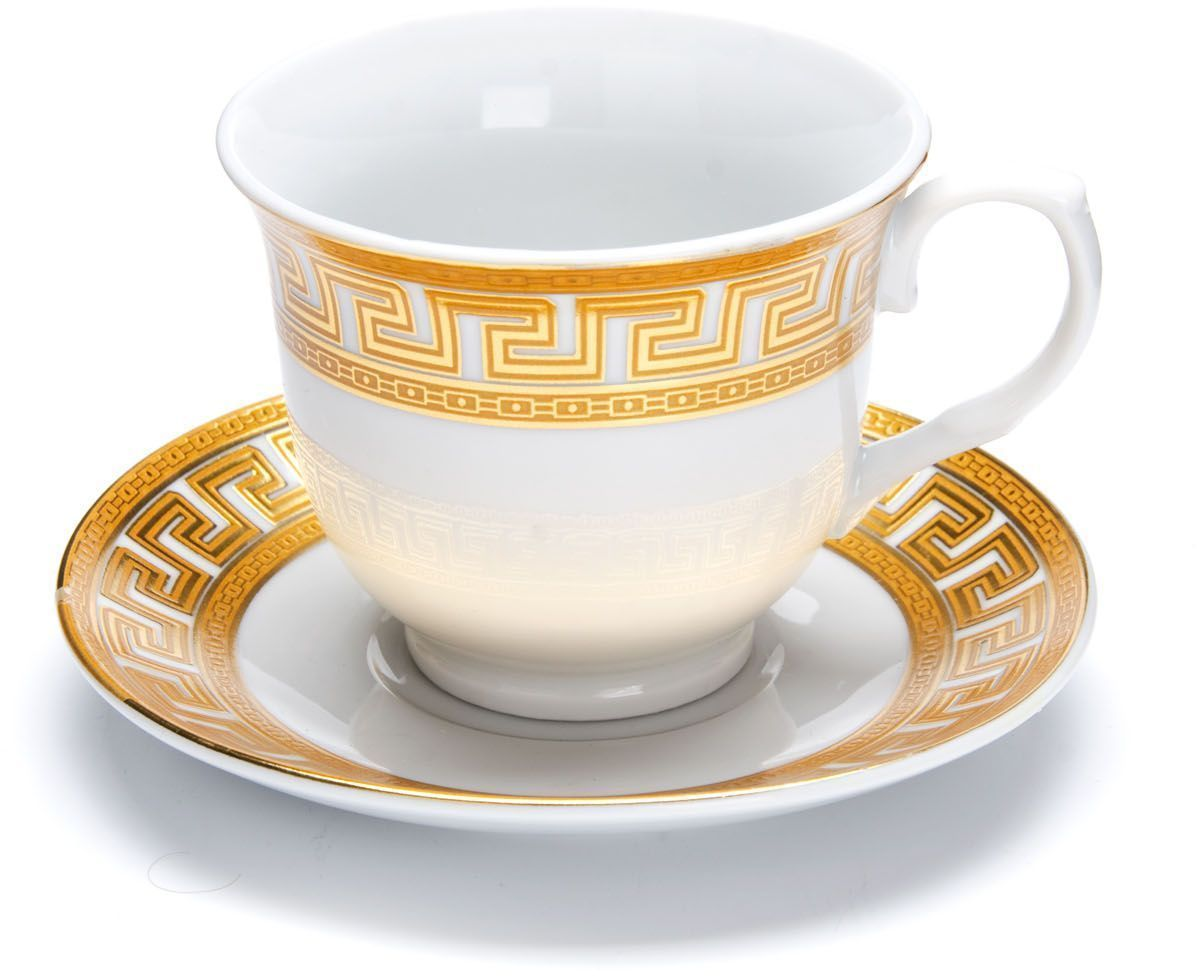 Чайный сервиз Loraine Версаче, 220 мл. 26422115510Чайный сервиз Loraine на 6 персон выполнен из высококачественной керамики белого цвета и украшен широким золотым орнаментом в греческом стиле. Изящный дизайн придется по вкусу и ценителям классики, и тем, кто предпочитает утонченность и изысканность. Сервиз упакован в круглую подарочную коробку. Каждый предмет надежно зафиксирован внутри коробки благодаря специальным выемкам. Элегантный и стильный чайный сервиз не только украсит сервировку стола, но и поднимет настроение и превратит процесс чаепития в одно удовольствие. Чайный сервиз - идеальный и необходимый подарок для вашего дома и для ваших друзей в праздники, юбилеи и торжества! В наборе: 6 чашек и 6 блюдец.