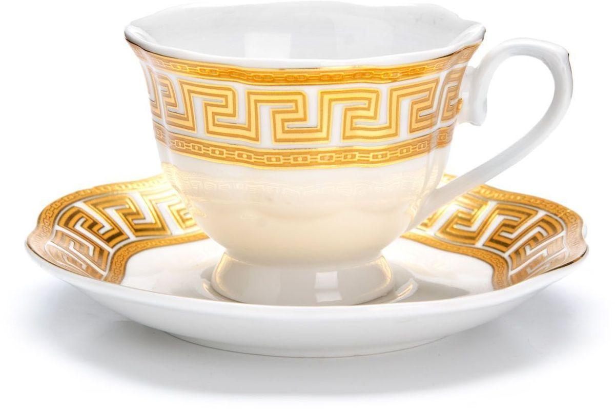 Кофейный сервиз Loraine, 80 мл, подарочная упаковка. 26439VT-1520(SR)Кофейный сервиз Loraine на 6 персон выполнен из высококачественной керамики белого цвета и украшен широким золотым орнаментом в греческом стиле. Изящный дизайн придется по вкусу и ценителям классики, и тем, кто предпочитает утонченность и изысканность. Набор упакован в подарочную коробку. Каждый предмет надежно зафиксирован внутри коробки благодаря специальным выемкам. Кофейный набор - идеальный и необходимый подарок для вашего дома и для ваших друзей в праздники, юбилеи и торжества! Также он станет отличным корпоративным подарком и украшением любой кухни. В наборе: 6 кофейных чашек, 6 блюдец.