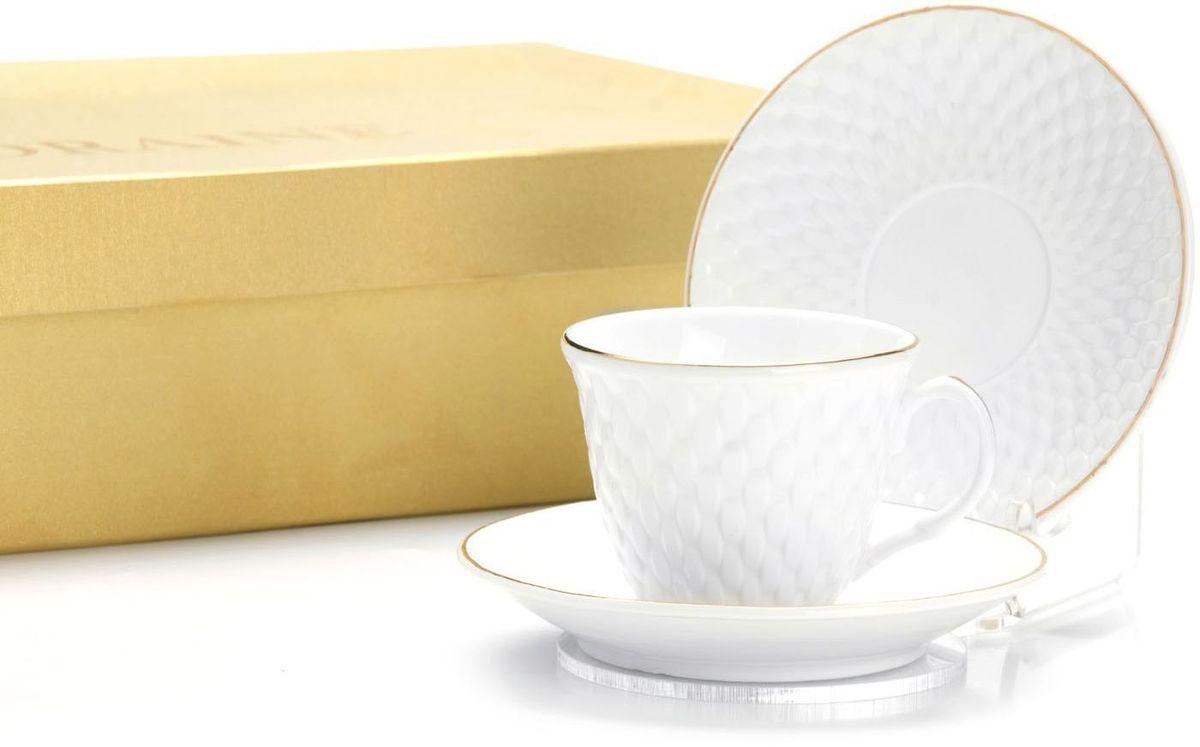Кофейный сервиз Loraine, 80 мл, 12 предметов. 26503115510Кофейный набор на 6 персон Loraine выполнен из высококачественного костяного фарфора - материала безопасного для здоровья и надолго сохраняющего тепло напитка. В наборе 6 кофейных чашек и 6 блюдец. Несмотря на свою внешнюю хрупкость, каждый из предметов набора обладает высокой прочностью и надежностью.Элегантный классический дизайн с тонкой золотой каймой делает этот кофейный набор прекрасным украшением любого стола.Набор аккуратно упакован в подарочную упаковку, поэтому его можно преподнести в качестве оригинального и практичного подарка для своих родных и самых близких.Подходит для мытья в посудомоечной машине.