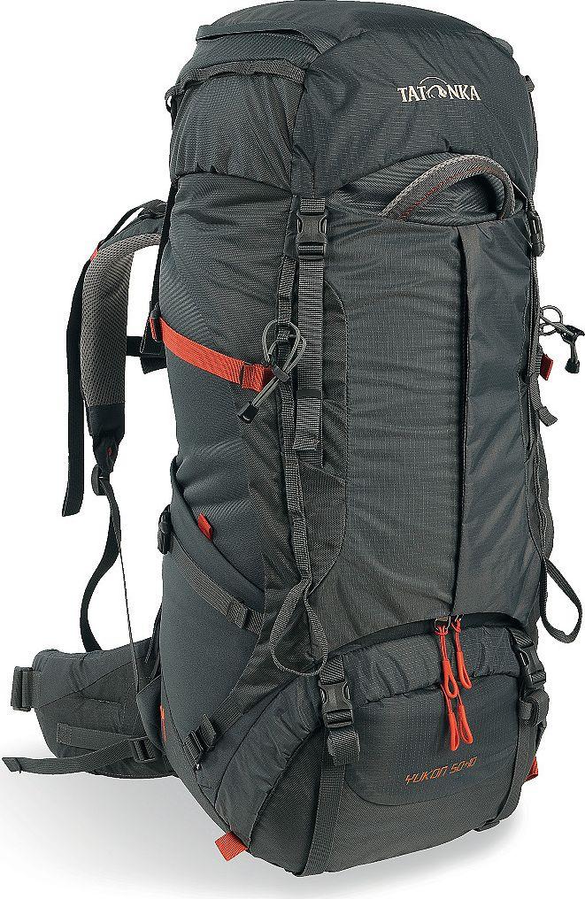 Рюкзак туристический женский Tatonka Yukon, цвет: темно-серый, 50+10 лKOC-H19-LEDКлассический туристический рюкзак - идеальный выбор для разнообразных походов. Рюкзак оптимизирован для грузов среднего веса (до 20-25 кг), и представляет собой идеальный баланс легкости, прочности и комфорта. Система V2 совершенствовалась с годами, и всегда получала самые лучшие оценки как от профессионалов, так и от новичков. В обновленном рюкзаке отлично сочетаются и обновленная система переноски, и более тонкие, но прочные материалы, и максимальный комфорт при переноске рюкзака. Yukon оснащен 3D-входом в основное отделение, что делает более эффективным и быстрым процесс упаковки рюкзака. Дно рюкзака выполнено из прочного непромокаемого материала Cordura.Преимущества и особенностиСистема переноски V2Разделенные верхнее и нижнее отделенияАнатомиские лямки, адаптированные для девушекФиксаторы для треккинговых палок или ледорубовПолностью адаптивная система настройки спиныКомпрессионные стропы по бокамПрочные ручки в передней и задней частях рюкзакаПрочные молнии размера 103D-вход в основное отделениеРегулируемая по высоте крышка рюкзакаКарман в крышкеВ коплекте - чехол от дождяВыход для питьевой системыДно из материала CorduraБоковые эластичные карманыДополнительные петли в центральной части рюкзакаОтделение для аптечки (пустое)Передний карман на молнии