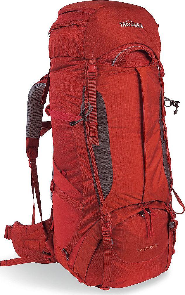 Рюкзак туристический женский Tatonka Yukon, цвет: красный, 60+10 л1351.254Классический туристический рюкзак Tatonka Yukon - идеальный выбор для разнообразных походов. Рюкзак оптимизирован для грузов среднего веса (до 20-25 кг), и представляет собой идеальный баланс легкости, прочности и комфорта. Система V2 совершенствовалась с годами, и всегда получала самые лучшие оценки как от профессионалов, так и от новичков. В обновленном рюкзаке отлично сочетаются и обновленная система переноски, и более тонкие, но прочные материалы, и максимальный комфорт при переноске рюкзака. Yukon оснащен 3D-входом в основное отделение, что делает более эффективным и быстрым процесс упаковки рюкзака. Дно рюкзака выполнено из прочного непромокаемого материала Cordura.Преимущества и особенности:- Система переноски V2;- Разделенные верхнее и нижнее отделения;- Анатомические лямки, адаптированные для девушек;- Фиксаторы для треккинговых палок или ледорубов;- Полностью адаптивная система настройки спины;- Компрессионные стропы по бокам;- Прочные ручки в передней и задней частях рюкзака;- Прочные молнии размера 10;- 3D-вход в основное отделение;- Регулируемая по высоте крышка рюкзака;- Карман в крышке;- В комплекте - чехол от дождя;- Выход для питьевой системы;- Боковые эластичные карманы;- Дополнительные петли в центральной части рюкзака;- Отделение для аптечки (пустое);-Передний карман на молнии.Размер: 74 x 30 x 24 см.