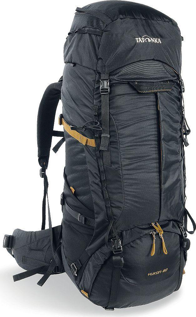 Рюкзак туристический Tatonka Yukon, цвет: черный, 60+10 л1353.040Классический туристический рюкзак Tatonka Yukon - идеальный выбор для разнообразных походов. Рюкзак оптимизирован для грузов среднего веса (до 20-25 кг), и представляет собой идеальный баланс легкости, прочности и комфорта. Система V2 совершенствовалась с годами, и всегда получала самые лучшие оценки как от профессионалов, так и от новичков. В обновленном рюкзаке отлично сочетаются и обновленная система переноски, и более тонкие, но прочные материалы, и максимальный комфорт при переноске рюкзака. Yukon оснащен 3D-входом в основное отделение, что делает более эффективным и быстрым процесс упаковки рюкзака. Дно рюкзака выполнено из прочного непромокаемого материала Cordura.Преимущества и особенности:- Система переноски V2;- Разделенные верхнее и нижнее отделения;- Анатомические лямки, адаптированные для девушек;- Фиксаторы для треккинговых палок или ледорубов;- Полностью адаптивная система настройки спины;- Компрессионные стропы по бокам;- Прочные ручки в передней и задней частях рюкзака;- Прочные молнии размера 10;- 3D-вход в основное отделение;- Регулируемая по высоте крышка рюкзака;- Карман в крышке;- В комплекте - чехол от дождя;- Выход для питьевой системы;- Боковые эластичные карманы;- Дополнительные петли в центральной части рюкзака;- Отделение для аптечки (пустое);-Передний карман на молнии.Размер: 74 x 32 x 24 см.