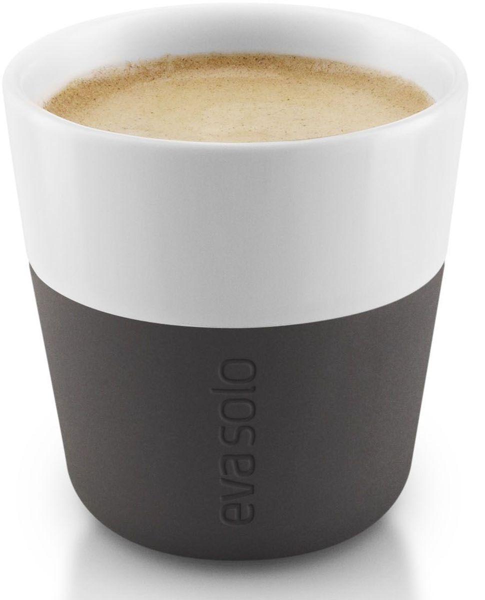 Чашки для эспрессо Eva Solo, 80 мл, 2 шт., цвет: черный115610Чашка для эспрессо от Eva Solo рассчитана на 80 мл - классическое количество эспрессо, а также стандарт для большинства кофе-машин. Чашка сделана из фарфора и имеет специальный силиконовый чехол, чтобы ее можно было держать в руках, не рискуя обжечь пальцы. Чехол легко снимается, и чашку можно мыть в посудомоечной машине. Умные и красивые предметы посуды от Eva Solo будут украшением любой кухни!