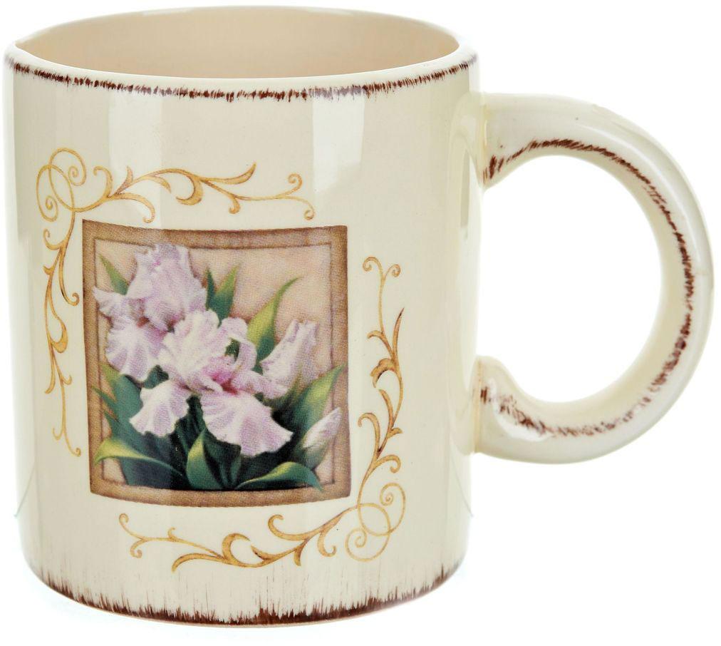 Кружка ENS Group Розовый ирис, 410 мл115510Кружка Розовый Ирис, выполненная из высококачественной керамики, украшена изображением цветка в рамке и узорами. Изделие оснащено удобной ручкой. Кружка сочетает в себе оригинальный дизайн и функциональность. Благодаря такой кружке пить напитки будет еще вкуснее.