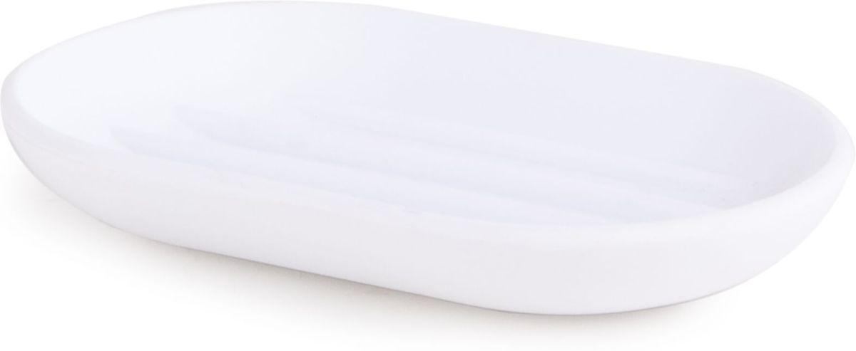 Мыльница Umbra Touch, цвет: белый, 2 х 7 х 9 см41619Функциональность мыльницы неоспорима - именно она защищает нашу раковину от мыльных подтеков и пятен. А как насчет дизайна? В Umbra уверены: такой простой и ежедневно используемый предмет должен выглядеть лаконично, но необычно. Ведь в небольшой ванной комнате не должно быть ничего вызывающе яркого. Немного экспериментировав с формой, дизайнеры создали мыльницу Touch, которая придется кстати в любом доме! Изготовлена из приятного на ощупь пластика, не скользит, а брать из нее мыло удобнее благодаря специальным желобкам на донышке.