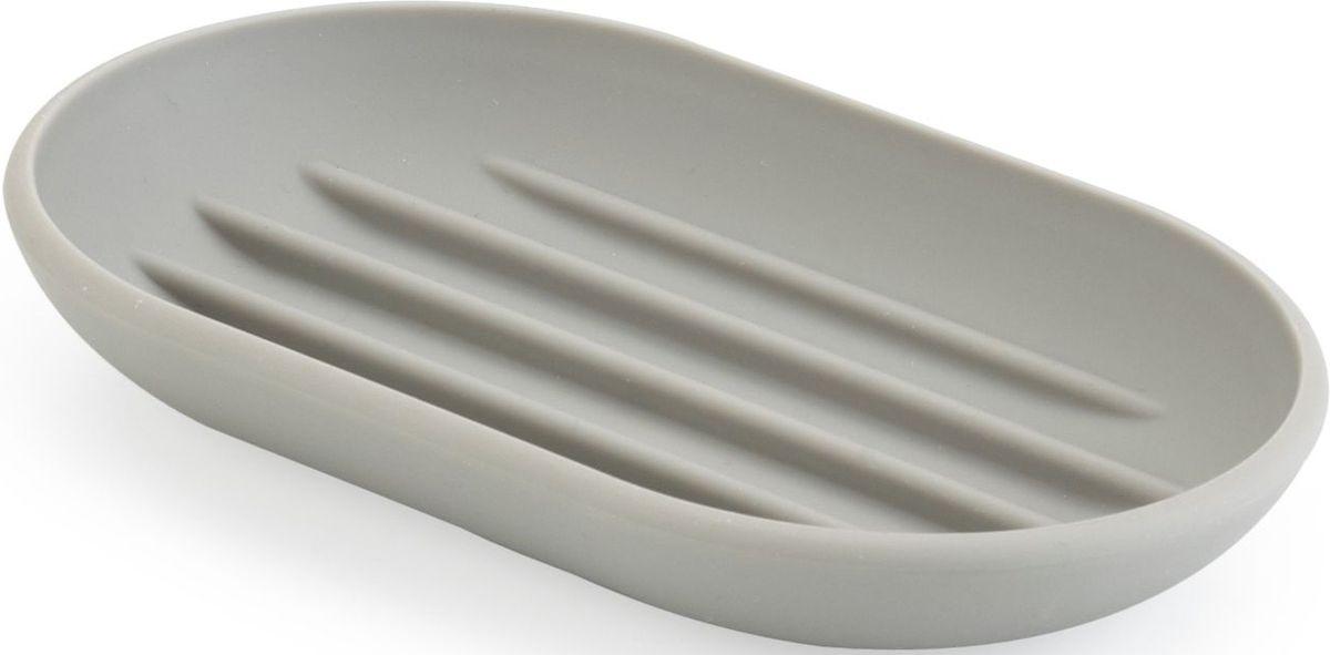 Мыльница Umbra Touch, цвет: серый, 2 х 13 х 9 смBH-UN0502( R)Функциональность мыльницы неоспорима - именно она защищает нашу раковину от мыльных подтеков и пятен. А как насчет дизайна? В Umbra уверены: такой простой и ежедневно используемый предмет должен выглядеть лаконично, но необычно. Ведь в небольшой ванной комнате не должно быть ничего вызывающе яркого. Немного экспериментировав с формой, дизайнеры создали мыльницу Touch, которая придется кстати в любом доме! Изготовлена из приятного на ощупь пластика, не скользит, а брать из нее мыло удобнее благодаря специальным желобкам на донышке.