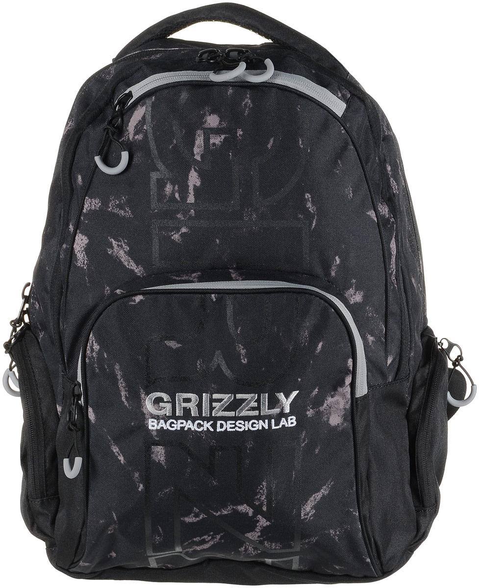 Рюкзак мужской Grizzly, цвет: черный, серый. RU-709-2/2RivaCase 8460 blackРюкзак Grizzly - это красивый и удобный рюкзак, который подойдет всем, кто хочет разнообразить свои будни. Рюкзак выполнен из плотного материала с оригинальным графическим принтом. Рюкзак содержит два вместительных отделения, каждое из которых закрывается на молнию. Внутри первого отделения имеется открытый накладной карман, на стенке которого расположился врезной карман на молнии. Второе отделение не содержит дополнительных карманов. Снаружи, по бокам изделия, расположены два кармана на застежках-молниях. Лицевая сторона дополнена двумя карманами на застежках-молниях. В нижнем кармане расположены четыре открытых накладных кармашка.Рюкзак оснащен мягкой укрепленной ручкой для переноски, петлей для подвешивания и двумя практичными лямками регулируемой длины.Практичный рюкзак станет незаменимым аксессуаром и вместит в себя все необходимое.