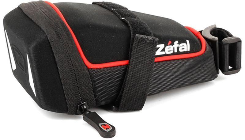 Велосумка под седло Zefal Iron Pack M-DS, 15 х 7 х 7 см7021Zefal Iron Pack M-DS незаметно размещается под седлом, надёжно закрепляясь за рамки седла и подседельный штырь ремешками с двойной липучкой велкро. Износостойкий материал сумки 840 D2 EVA и молнии с влагозащитой не пропускают внутрь воду и пыль, вы можете смело перевозить в ней телефон, ключи и документы. Для Вашей большей безопасности, на сумку нанесены светоотражающие элементы.ZEFAL – старейший французский производитель велосипедных аксессуаров премиального качества, основанный в 1880 году, является номером один на французском рынке велосипедных аксессуаров.• Крепление за рамки седла и подседельный штырь• Объём 0,6 л.• Материал сумки 840 D2 EVA• Молнии с влагозащитой• Светоотражающие элементы.
