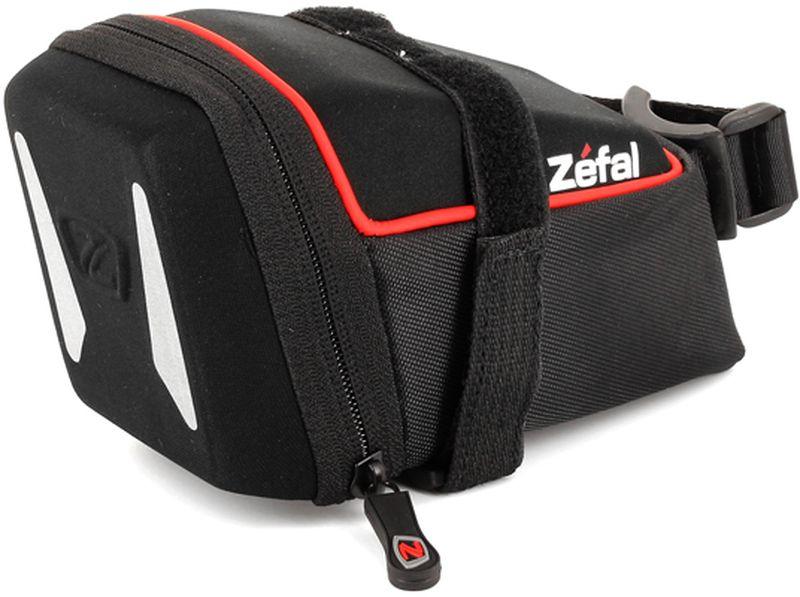 Велосумка под седло Zefal Iron Pack L-DS, 13 х 6 х 6 смZ90 blackZefal Iron Pack L-DS незаметно размещается под седлом, надёжно закрепляясь за рамки седла и подседельный штырь ремешками с двойной липучкой велкро. Износостойкий материал сумки 840 D2 EVA и молнии с влагозащитой не пропускают внутрь воду и пыль, вы можете смело перевозить в ней телефон, ключи и документы. Для вашей большей безопасности на сумку нанесены светоотражающие элементы.ZEFAL – старейший французский производитель велосипедных аксессуаров премиального качества, основанный в 1880 году, является номером один на французском рынке велосипедных аксессуаров.• Крепление за рамки седла и подседельный штырь• Объём 0,8 л.• Материал сумки 840 D2 EVA• Молнии с влагозащитой• Светоотражающие элементы.
