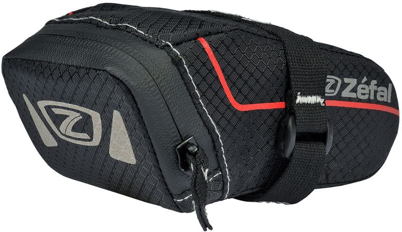 Велосумка под седло Zefal Z Light Pack XS, 13 х 6 х 6 см7049Zefal Z Light Pack XS - лёгкая сумка для самого необходимого! Больше не нужно думать, куда положить ключи, монтажки и заплатки для колёс. Z Light Pack XS незаметно крепится за рамки седла и предоставляет быстрый доступ к своему содержимому когда это необходимо. Износостойкий и лёгкий материал сумки 420D Ripstop и молнии с влагозащитой не пропускают внутрь воду и пыль. Для вашей большей безопасности на сумку нанесены светоотражающие элементы.ZEFAL – старейший французский производитель велосипедных аксессуаров премиального качества, основанный в 1880 году, является номером один на французском рынке велосипедных аксессуаров.• Крепление на рамки седла• Объём 0,3 л.• Материал сумки и молнии 420D Ripstop• Молнии с влагозащитой• Светоотражающие элементы.