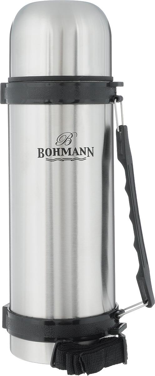 Термос Bohmann, цвет: стальной, черный, 1,2 л115510Дорожный термос Bohmann выполнен из нержавеющей стали с матовой полировкой. Двойные стенки сохраняют температуру напитков длительное время. Внутренняя колба выполнена из высококачественной нержавеющей стали. Термос снабжен плотно прилегающей закручивающейся пластиковой пробкой с нажимным клапаном и укомплектован теплоизолированной крышкой, которую можно использовать как чашку. Для того чтобы налить содержимое термоса нет необходимости откручивать пробку. Достаточно надавить на клапан, расположенный в центре. Изделие оснащено эргономичной ручкой и съемным ремнем для удобной переноски.Удобный термос Bohmann станет незаменимым спутником в ваших поездках.Высота термоса (с учетом крышки): 31 см.Диаметр горлышка: 5 см.Диаметр чашки (по верхнему краю): 9,5 см.Высота чашки: 7 см.Ширина ремня: 2 см.Длина ремня: 95 см.