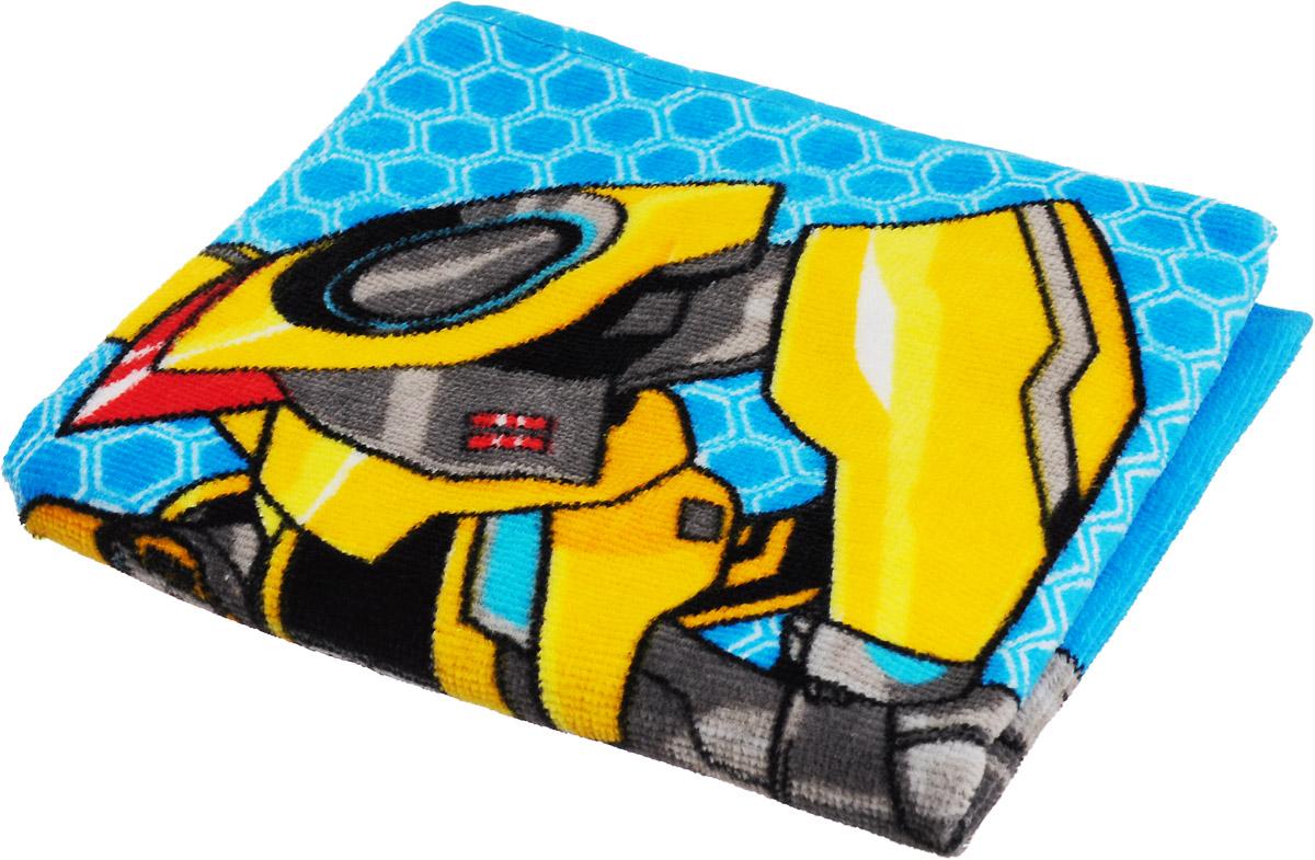 Bravo Полотенце детское Трансформеры цвет голубой желтый 33 x 70 смCLP446Мягкое хлопковое полотенце Bravo Трансформеры подарит вам и вашему малышу мягкость и необыкновенный комфорт в использовании. Полотенце украшено изображением робота-трансформера из мультфильма Transformers: Robots in Disguise. Красочное изображение любимого героя и невероятная мягкость полотенца обязательно приведут в восторг вашего ребенка и превратят любое купание в веселую и увлекательную игру. Ткань не вызывает аллергических реакций, обладает высокой гигроскопичностью и воздухопроницаемостью. Полотенце великолепно впитывает влагу и не теряет своих свойств после многократной стирки. Порадуйте себя и своего ребенка таким замечательным подарком! Режим стирки: при 40°С.