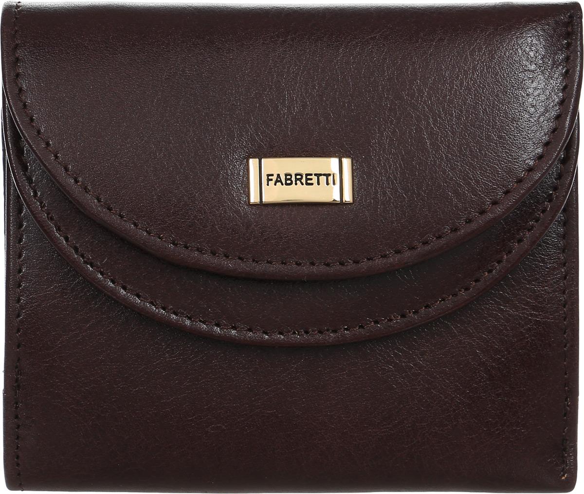Кошелек женский Fabretti, цвет: красно-коричневый. FA007/1BM8434-58AEЭлегантный женский кошелек от итальянского бренда Fabretti выполнен из натуральной мягкой и гладкой кожи. Модный коричневый цвет и аккуратная фурнитура, выполненная под серебро, прибавляют дизайну модели утонченности и изысканности. На лицевой стороне расположен удобный карман для мелочи, который закрывается на застежку, и 2 отделения для кредитных карточек. Внутри имеются два вместительных отделения для купюр. Кошелек закрывается на заклепку.