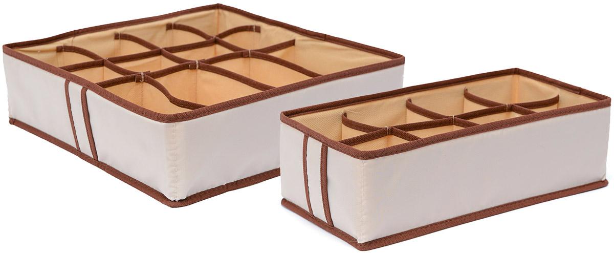 Набор органайзеров Homsu Гармония, 2 штБрелок для ключейНабор органайзеров Homsu Гармония, выполненный из полиэстера и картона, предназначен для удобного и компактного хранения белья и мелких вещей. В набор входят 2 органайзера. Органайзер на 12 ячеек - он сохранит форму вашего белья,компактен, не занимает много места, и в то же время может вместить несколько вещей.Органайзер на 8 ячеек - в него можно сложить носки, трусики и прочие небольшие предметы гардероба, множество ячеек не позволит белью смяться и перепутаться. Выбирая набор органайзеров, вы приобретаете практичное хранение вещей, стильные аксессуары для интерьера и свободное пространство.