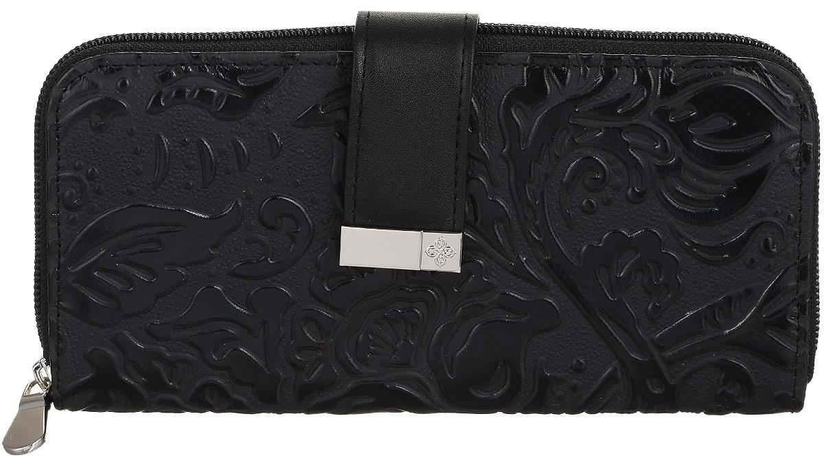 Портмоне женская Dimanche Elite. Арабеска, цвет: черный. 996/177-080-06Стильное женское портмоне Dimanche Elite. Арабеска выполнено из натуральной кожи с рельефным рисунком. Внутри находятся четыре отделения для купюр, карман для мелочи на застежке-молнии, шесть кармашков для визиток и пластиковых карт, прорезной карман на застежке-молнии и потайной карман. Портмоне закрывается на застежку-молнию и дополнительно на хлястик с магнитной кнопкой.Изделие упаковано в фирменную коробку.Такое портмоне станет замечательным подарком человеку, ценящему качественные и практичные вещи.