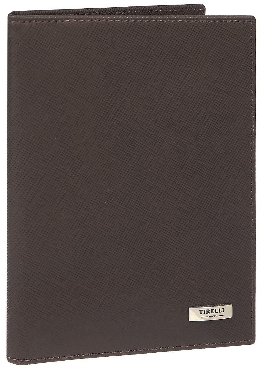 Зажим для денежных банкнот Tirelli, цвет: коричневый. 15-305-03INT-06501Зажим для денежных банкнот Tirelli изготовлен из натуральной кожи. Внутри содержится съемный блок из 6 прозрачных пластиковых файлов разного размера для автодокументов. С внутренней стороны обложки имеется 4 прорезных кармашка для пластиковых карт и 2 потайных кармашка. Стильный зажим не только защитит ваши документы, но и станет стильным аксессуаром, подчеркивающим ваш образ. Изделие упаковано в подарочную коробку синего цвета с логотипом фирмы Tirelli