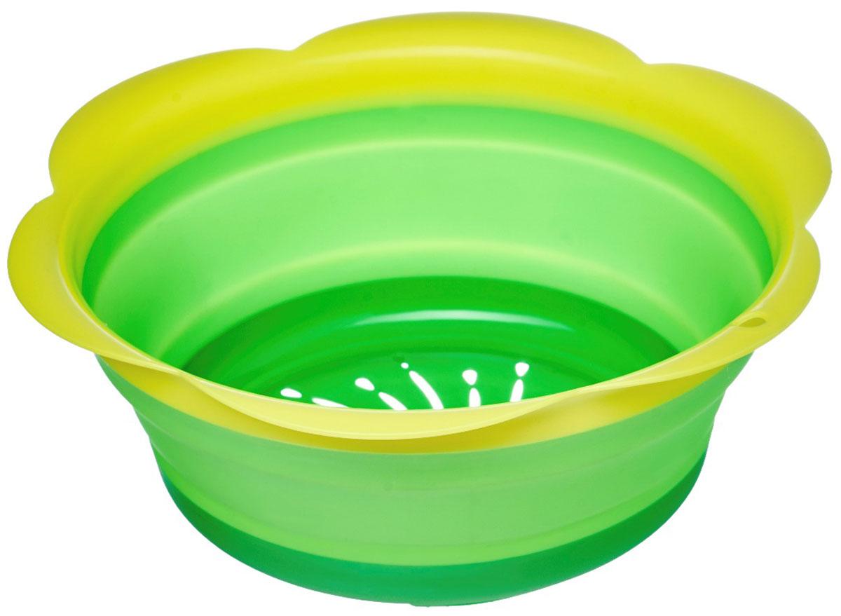Дуршлаг Walmer Rainbow, складной, цвет: зеленый, салатовый, диаметр 22 см115510Дуршлаг Walmer Rainbow изготовлен из качественного пищевого силикона с пластиковыми деталями, с помощью которых он держит форму. Благодаря гибкости материала, дуршлаг легко складывается и занимает минимум места при хранении. В таком дуршлаге удобно промывать ягоды, фрукты, овощи, а также процеживать макароны. Дуршлаг является необходимым аксессуаром для каждой кухни. Он станет полезным и практичным приобретением.Диаметр (по верхнему краю): 22 см.Высота стенки: 8,5 см.