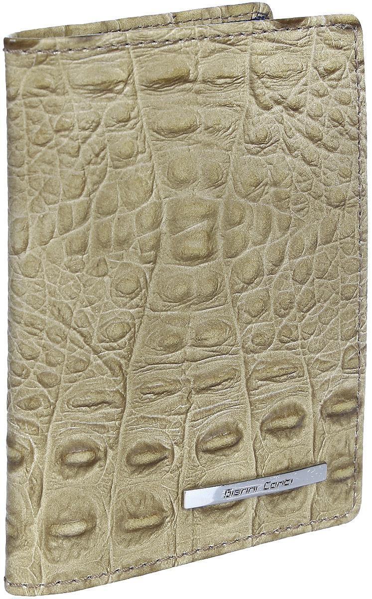 Обложка для паспорта Gianni Conti, цвет: песочный. 1937455INT-06501Стильная обложка Gianni Conti выполнена из натуральной кожи с фактурным тиснением под крокодила и оформлена металлической пластинкой с надписью в виде логотипа бренда.На внутреннем развороте справа расположено шесть кармашков для пластиковых карт и визиток.Ширина левого разворота 3 см, правого 7 см. Оба разворота изготовлены из натуральной кожи.Такая обложка не только поможет сохранить внешний вид ваших документов и защитит их от повреждений, но и станет ярким аксессуаром, который подчеркнет ваш образ. Обложка упакована в подарочную картонную коробку желтого цвета с логотипом фирмы.