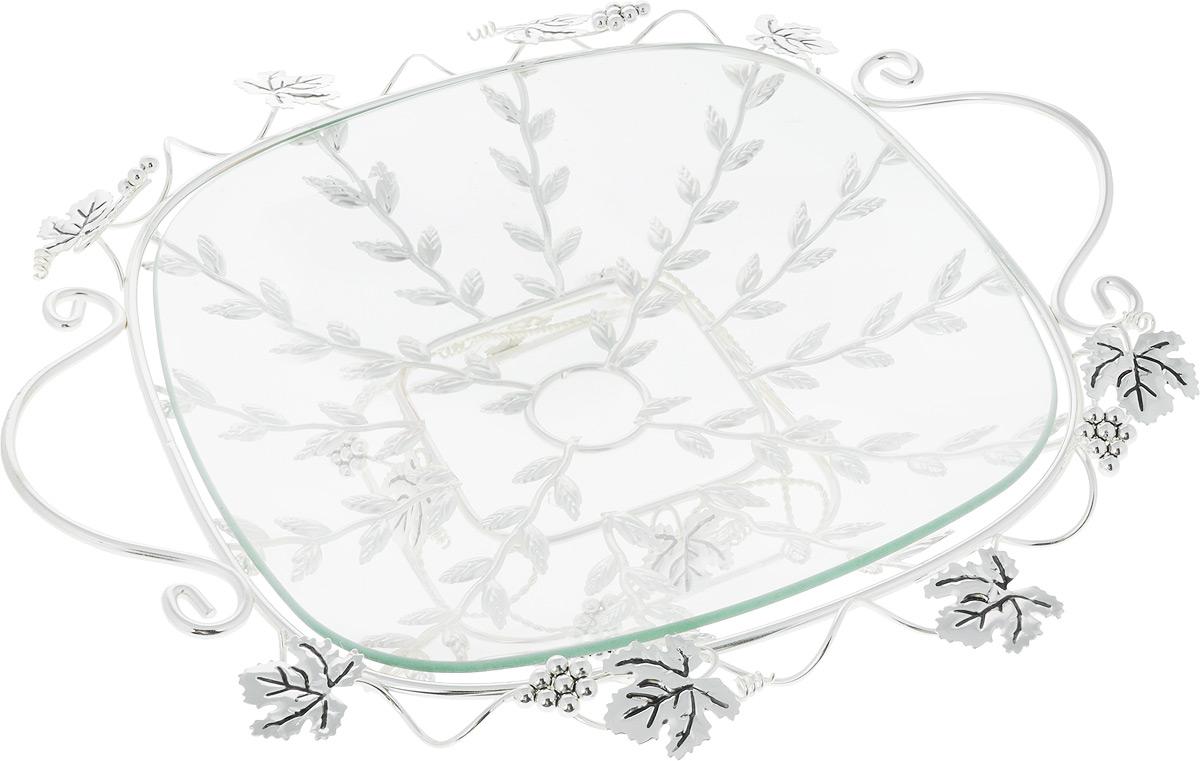 Фруктовница Marquis, 35 х 35 х 9 смАн 0/6373Фруктовница Marquis выполнена из стали с серебряно-никелевым покрытием и снабжена съемнымподдоном из прочного стекла. Фруктовница выполнена в виде плетеной стальной решетки, украшенной листьями и гроздьями винограда. По бокам имеются удобные ручки.Отлично подойдет для подачи фруктов или сладостей.Стильная форма и интересное исполнение идеально впишутся в любой интерьер.Не рекомендуется использовать в микроволновой печи. Мыть теплой водой с применением нейтральных моющих средств.Диаметр фрутовницы: 35 см х 35 см.Ширина фрутковницы с учетом ручек: 43 см.Высота: 9 см.