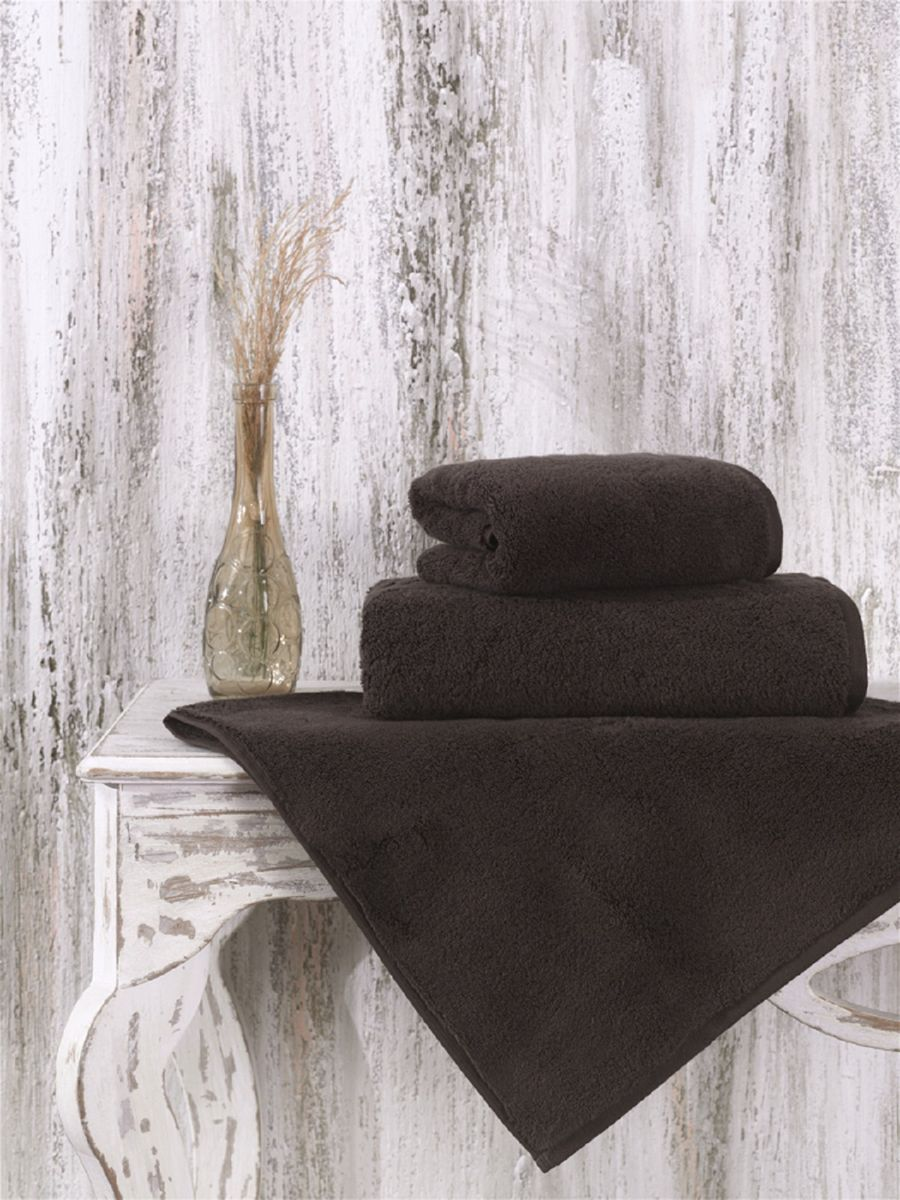 Полотенце Karna Mora, цвет: коричневый, 70 х 140 см. 2625/CHAR0011204Полотенце Karna Mora изготовлено из микрокоттона.Микрокоттон представляет собой разновидность хлопка, отличающуюся от других типов способом и качеством обработки нити. Метод состоит в шлифовке и рассечении волокон, что приводит к уменьшению их толщины. Тщательная обработка нитей повышает качество изделий. Основными свойствами материала являются прочность, мягкость и отличное влагопоглощение. Размер полотенца: 70 х 140 см.