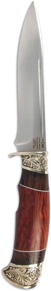 Нож Ножемир Демидов, булатная сталь, с ножнами, общая длина 27 см. (5487)бS7302Ножемир Демидов — это оптимальный вариант для тех, кто выбирает нож по соотношению цена-качество. Клинок ножа выполнен из кованой булатной стали, что обеспечивает ножу отличные рабочие характеристики. При этом нож имеет стильную внешность и способен украсить собой любую коллекцию. Рукоять ножа изготовлена из древесины ценных пород с красивым природным узором. Оковка и навершие рукояти выполнены из мельхиора, что, несомненно, повышает ценность этой модели.Общая длина ножа: 27 см.Твердость стали: 62-64 HRC.