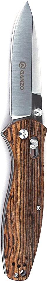 Нож туристический Ganzo, цвет: коричневый, стальной, длина лезвия 8,9 см. G738-WD1G738-WD1Аккуратный и качественный нож Ganzo необходим буквально каждому, кто предпочитает отдыхать активно. Ведь он понадобится и на рыбалке, и во время занятий экстремальными видами спорта, и просто на пикнике. Нож вполне подойдет для всех этих целей.Чтобы выдержать эксплуатацию в таких жестких условиях, какие предполагает отдых на природе, нож должен быть собран из самых качественных комплектующих. Так, клинок выпущен из нержавейки, которая нашла широкое применение в этой отрасли. Марка 440С содержит в составе целый ряд легирующих добавок, которые позволяют улучшить ее свойства, повысить стойкость к ржавлению и способность оставаться остро заточенной. Геометрия клинка грамотно продумана. Это drop point с пониженной линией обуха. Острие клинка немного приподнято, за счет чего режущая кромка фактически удлиняется. Заточка ножа ровная и ее легко подновить, используя самую обычную карманную точилку. Что касается габаритов клинка, то это длина 8,9 см, позволяющая легко использовать нож для чистки рыбы, приготовления бутербродов, и толщина 3,3 мм.В каждом из крайних положений (открытый и сложенный нож) лезвие хорошо фиксируется. Этому способствует использование замка Axis-Lock. В нем применяется небольшой металлический штифт, который и определяет положение клинка. Разблокировать такой замок можно даже одной рукой, что является несомненным преимуществом для туристов и охотников. Для рукоятки был выбран материал дерево.Длина лезвия: 8,9 см.Общая длина ножа: 21 см.Вес ножа: 133 г.