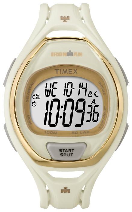 Наручные часы женские Timex Ironman, цвет: золотистый. TW5M06100BP-001 BKКорпус 41 мм белого цвета с золотистыми вставками; электронный циферблат; память на 50 тренировок с функцией записи до 99 временных отрезков, 100-часовой хронограф, 2 секундомера по 24-часа, 3 будильника, 2 часовых пояса, подсветка INDIGLO, 10 ATM.