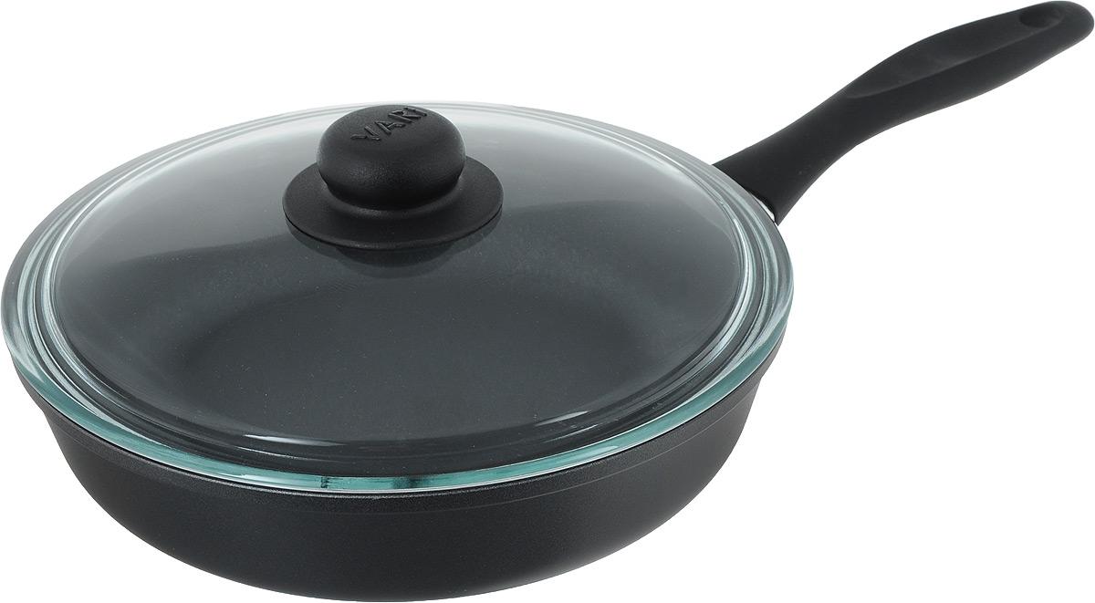 Сковорода Vari Cerama с крышкой, с антипригарным покрытием. Диаметр 24 смK31124/12Сковорода Vari Cerama выполнена из алюминия с антипригарным покрытием. Утолщенное дно обеспечивает равномерное распределение и длительное сохранение тепла. Жаростойкое внешнее покрытие позволяет использовать сковороды на стеклокерамических поверхностях. Не выделяет вредных веществ! Не содержит PFOA. Изделие оснащено ручкой, выполненной из пластика. Такая ручка не нагревается в процессе готовки и обеспечивает надежный хват. Крышка, изготовленная из жаропрочного стекла, позволяет следить за приготовлением пищи без потери тепла. Сковорода Vari Cerama станет незаменимой помощницей на кухне и прослужит долгие годы. Подходит для газовых, электрических и стеклокерамических плит. Высота стенки: 6 см. Длина ручки: 17,5 см.