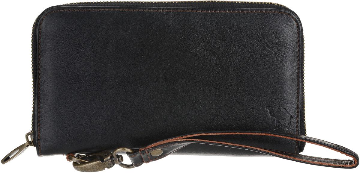 Портмоне мужское Dimanche Сахара, цвет: черный. 7621-022_516Удобное вместительное функциональное портмоне из натуральной кожи. Внутреннее пространство разделено на три части. Есть карман на молнии для купюр, карман для мелочи на молнии 20 различных кармашков для визиток/кредиток, прозрачное окошко. На задней стороне портмоне карман на молнии. Имеется отстегивающийся хлястик для ношения на руке. Упаковано в картонную подарочную коробку.