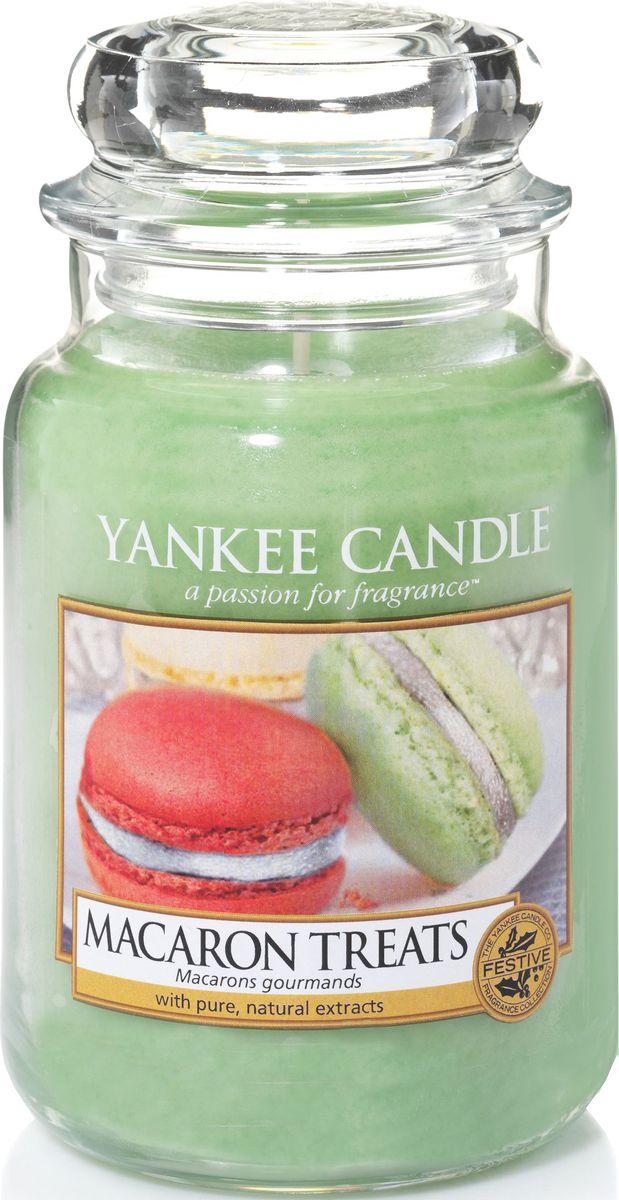 Ароматическая свеча Yankee Candle Макаруны / Macaron Treats, 110-150 ч1521052EАроматическая свеча Yankee Candle не только окутает вас волшебным ароматом, но еще и прекрасно впишется в интерьер. Использовать изделие можно как в доме, так и на веранде или в саду. Свеча в стеклянной банке с крышкой выполнена из высокоочищенного парафина с добавлением натуральных эфирных масел. Стекло делает горение свечи безопасным.Описание ароматической композиции: классический парижский макарун - сладкий и легкий, как воздух, с нотами ванили, миндаля и, конечно же, сахара.Верхняя нота: Кондитерский сахар.Средняя нота: Печенье, Миндаль.Базовая нота: Ваниль.