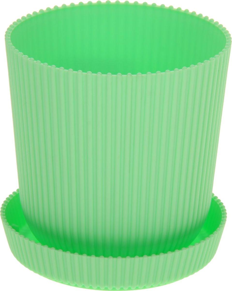 Горшок для цветов ТЕК.А.ТЕК Le Gaufre, с поддоном, цвет: зеленый, 1,8 л531-105Любой, даже самый современный и продуманный интерьер будет не завершённым без растений. Они не только очищают воздух и насыщают его кислородом, но и заметно украшают окружающее пространство. Такому полезному члену семьи просто необходимо красивое и функциональное кашпо, оригинальный горшок или необычная ваза! Мы предлагаем - Горшок для цветов с поддоном 1,8 л Le Gaufre, d=13,5 см, цвет зеленый! Оптимальный выбор материала пластмасса! Почему мы так считаем? Малый вес. С лёгкостью переносите горшки и кашпо с места на место, ставьте их на столики или полки, подвешивайте под потолок, не беспокоясь о нагрузке. Простота ухода. Пластиковые изделия не нуждаются в специальных условиях хранения. Их легко чистить достаточно просто сполоснуть тёплой водой. Никаких царапин. Пластиковые кашпо не царапают и не загрязняют поверхности, на которых стоят. Пластик дольше хранит влагу, а значит растение реже нуждается в поливе. Пластмасса не пропускает воздух корневой системе растения не грозят резкие перепады температур. Огромный выбор форм, декора и расцветок вы без труда подберёте что-то, что идеально впишется в уже существующий интерьер. Соблюдая нехитрые правила ухода, вы можете заметно продлить срок службы горшков, вазонов и кашпо из пластика: всегда учитывайте размер кроны и корневой системы растения (при разрастании большое растение способно повредить маленький горшок)берегите изделие от воздействия прямых солнечных лучей, чтобы кашпо и горшки не выцветалидержите кашпо и горшки из пластика подальше от нагревающихся поверхностей. Создавайте прекрасные цветочные композиции, выращивайте рассаду или необычные растения, а низкие цены позволят вам не ограничивать себя в выборе.