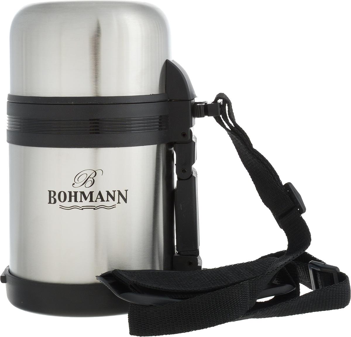 Термос Bohmann, цвет: стальной, черный, 0,6 лVT-1520(SR)Дорожный термос Bohmann выполнен из нержавеющей стали с матовой полировкой. Двойные стенки сохраняют температуру напитков длительное время. Внутренняя колба выполнена из высококачественной нержавеющей стали. Термос снабжен плотно прилегающей закручивающейся пластиковой пробкой с нажимным клапаном и укомплектован теплоизолированной крышкой, которую можно использовать как чашку. Для того чтобы налить содержимое термоса нет необходимости откручивать пробку. Достаточно надавить на клапан, расположенный в центре.Изделие оснащено эргономичной ручкой и съемным ремнем для удобной переноски, который регулируется по длине.Удобный термос Bohmann станет незаменимым спутником в ваших поездках.Высота термоса (с учетом крышки): 18,5 см.Диаметр горлышка: 7,5 см.Диаметр чашки (по верхнему краю): 9,5 см.Высота чашки: 5,7 см.Ширина ремня: 2 см.