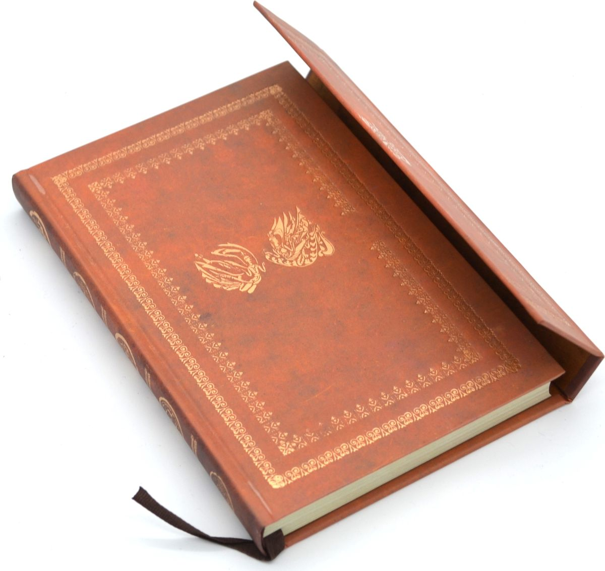Карамба Блокнот на магните 98 листов цвет коричневый72523WDСтильный блокнот Карамба с жесткой обложкой - незаменимый атрибут современного человека, необходимый для рабочих и повседневных записей в офисе и дома. Магнитная застежка. 98 цветных листов с нежным рисунком.
