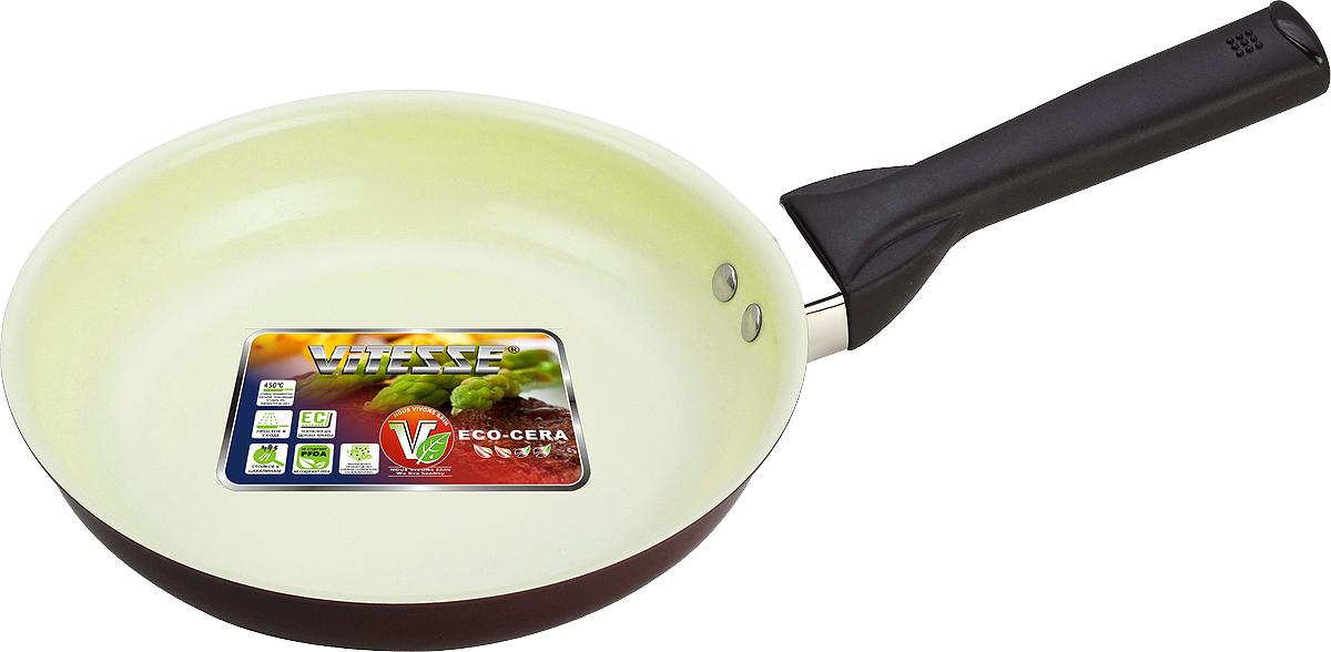 Сковорода Vitesse. Диаметр 24 смFS-91909Сковорода Vitesse станет незаменимым помощником на кухне. Особенности:Сковорода изготовлена из высококачественного алюминия, толщина - 2,5 мм. Внешнее элегантное цветное покрытие, подвергшееся высокотемпературной обработке. Бакелитовая, высокопрочная, огнестойкая, не нагревающаяся ручка удобной формы на заклепках.Внутреннее керамическое покрытие. Быстрый нагрев и равномерное распределение тепла по всей поверхности. Стойкое керамическое покрытие позволяет готовить при температуре до 450 градусов. Можно использовать металлическую лопатку. Пригодна для мытья в посудомоечной машине. Подходит для всех видов варочных панелей. Характеристики:Материал: алюминий. Диаметр: 24 см. Высота стенок:5 см.Артикул:VS-2215.