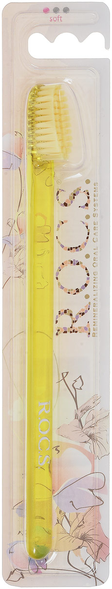 R.O.C.S. Зубная щетка Классическая, мягкая, цвет: желтыйSatin Hair 7 BR730MNЗубная щетка R.O.C.S. Классическая разработана при участии стоматологов. Нетрадиционная скошенная подстрижка щетины обеспечивает:Эффективную чистку: качественное удаление зубного налета и поверхностных окрашиваний;Высокое качество очистки труднодоступных участков зубного ряда;Легкий доступ к дальним зубам. Тонкая ручка предотвращает излишнее давление при чистке. Высококачественная щетина имеет закругленные и отполированные на концах текстурированные щетинки, которые обеспечивают быстрое и интенсивное очищение благодаря увеличенной очищающей поверхности и особенностям аквадинамики волокна.Товар сертифицирован.
