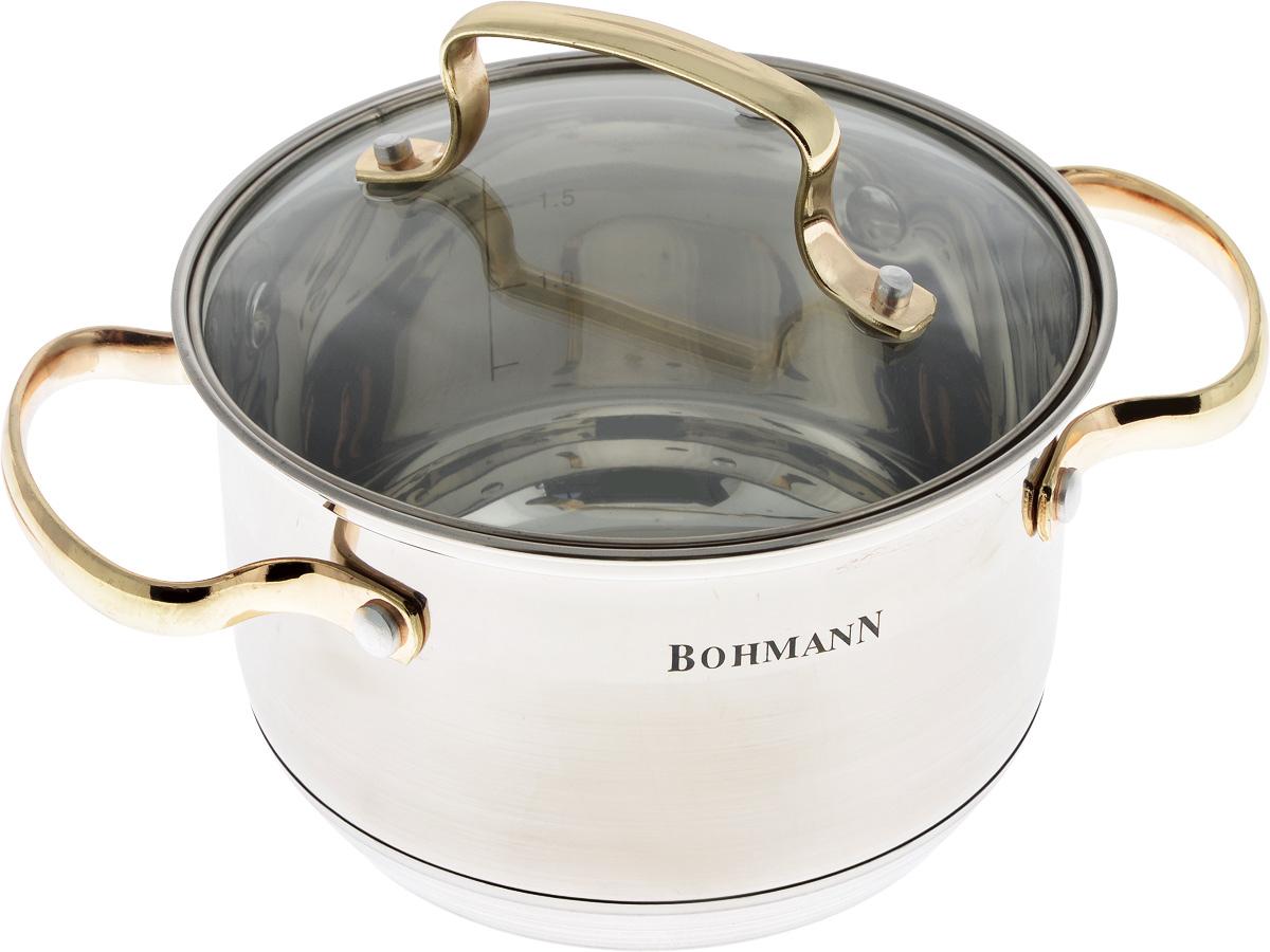 Кастрюля Bohmann с крышкой, цвет: серый, золотой, 2,1 лFS-80418Кастрюля Bohmann изготовлена из высококачественной нержавеющей стали. Нержавеющая сталь отличается высокой экологической чистотой и долговечностью, устойчива к воздействию пищевых кислот, не образует соединений с компонентами пищи. Толстое многослойное дно обеспечивает быстрый нагрев и равномерное распределение тепла по всей поверхности. Жаропрочная стеклянная крышка плотно прилегает к краям посуды, имеет отверстие для выхода пара, сохраняя аромат и вкус блюд. При этом можно наблюдать за готовностью пищи без потери тепла. Крышка и кастрюля оснащены удобными ручками.Кастрюля подходит для всех плит, включая индукционные. Можно мыть в посудомоечной машине.Диаметр кастрюли (по верхнему краю): 16 см.Диаметр дна: 13 см.Высота стенки: 10,5 см.Ширина кастрюли (с учетом ручек): 24 см.