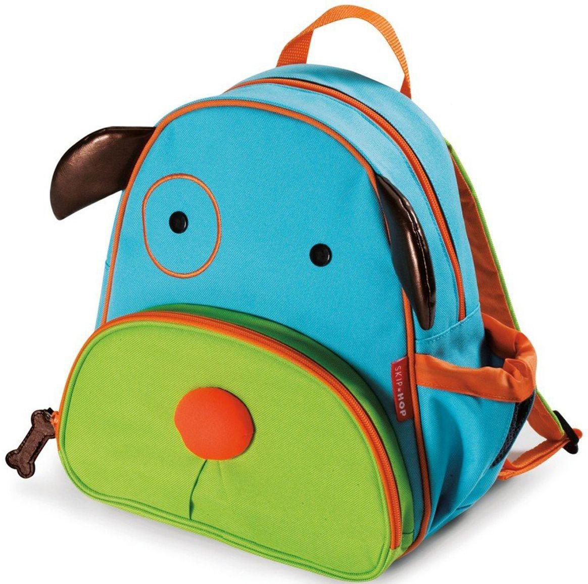 SkipHop Рюкзак дошкольный Собака72523WDРюкзачок Skip Hop Zoo Pack каждый день будет радовать вашего малыша, вызывать улыбки у прохожих и зависть у сверстников. С ним можно ходить в детский сад, спортивные секции, на прогулку, в гости к бабушке или ездить на экскурсии. В основной отсек легко поместится книжка, альбом для рисования, краски, фломастеры, любимая игрушка и контейнер с едой, а специальный кармашек сбоку предназначен специально для бутылочки с водой. Передний кармашек на молнии предназначен для мелких вещичек. Внутренний кармашек на резиночке зафиксирует положение содержимого: не даст выпасть фломастерам или сломаться киндер-сюрпризу. Рюкзачок выполнен из прочной ткани, способной выдерживать бесконечное количество стирок в машинке. Лямки рюкзачка мягкие, регулируемые. • Размер: 11 x 25 х 29 см. • Для детей с 3 лет.