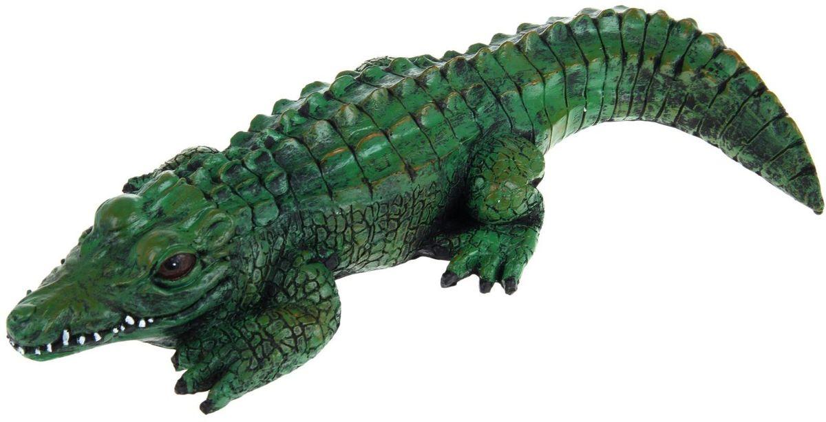 Фигура садовая Крокодил, цвет: изумрудный, 38 х 15 х 7 см1034Сад — гордость дачника. Сделайте любимый участок ещё наряднее! Украсьте его оригинальной фигуркой из долговечного материала. Она обновит привычный ландшафт и сделает его неповторимым.Фигурку можно использовать не только в качестве декора садового участка, но и в качестве сувенира для дома. Эффектно украсьте прихожую, чтобы приятно удивить гостей, или сделайте уютнее зелёный уголок, дополнив его этой скульптурой.