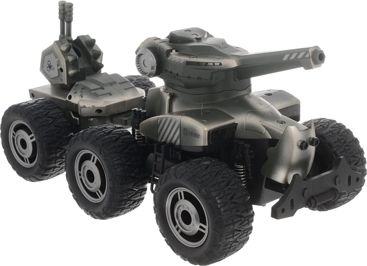 """Машина с прицепом на радиоуправлении Yako """"Chariot BB Bullet"""" - это потрясающая игрушка, играя с которой, мальчик получит море положительных эмоций. Игрушечная машинка похожа на танк, правда, немного альтернативной версии, так как вместо гусениц у нее четыре больших колеса. Самое интересное, что игрушечный танк действительно может стрелять. В комплект входят пульки.Управление происходит при помощи пульта по отдельности правой и левой стороной колес, что позволяет не только двигаться в заданном направлении, но и вращаться на месте. Мощный внедорожник на огромных колесах с настоящими пружинными амортизаторами. Благодаря выдающимся характеристикам ходовой части играть с машиной можно на улице, при этом она будет легко преодолевать значительные препятствия. Модель оснащена световыми эффектами (светятся фары).Пульт управления работает на частоте 27 MHz. Машина работает от сменного аккумулятора (входит в комплект). Зарядка происходит при помощи зарядного устройства (входит в комплект).Пульт управления работает от батарейки 9V типа """"Крона"""" (входит в комплект)."""